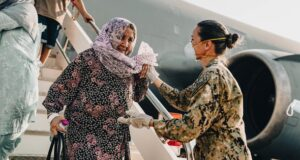 Greeting Afghan refugee